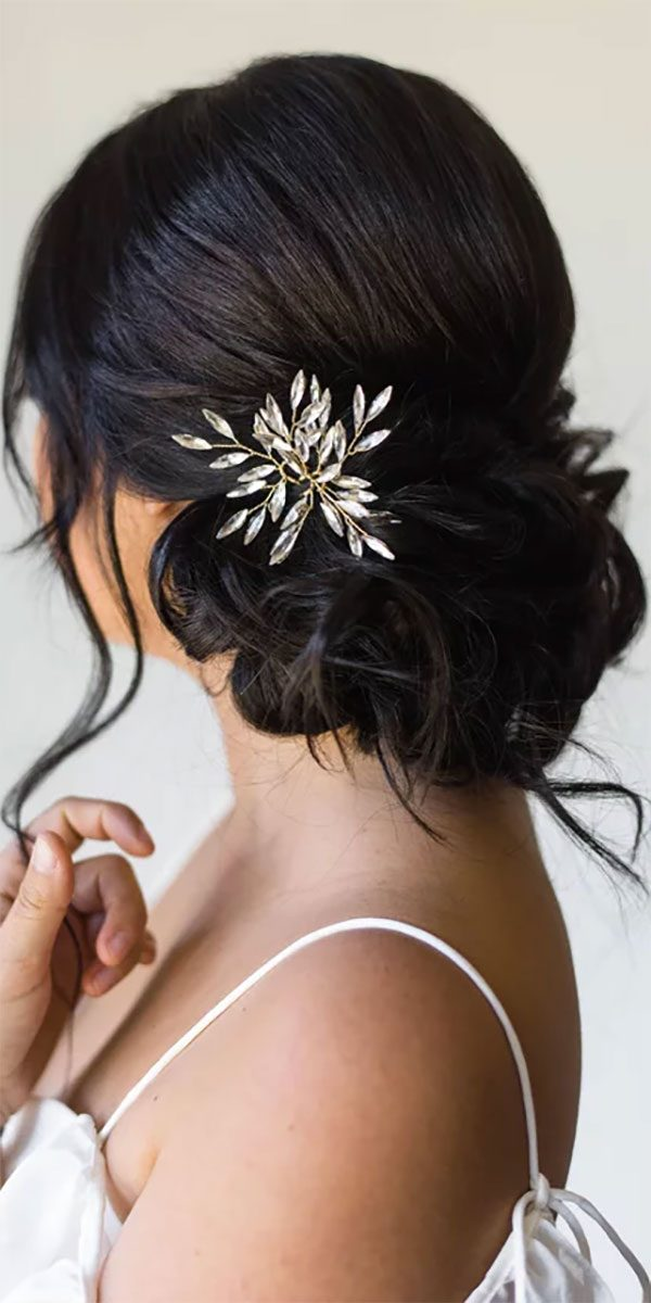 Rhineston bobby pins for wedding hair accessories. Cute in holiday hair, too because they look a little like a snowflake! The pic shows a set of three hair pins. $56.00 (you can get just two for $40.00). Buy them in the My Online Wedding Help products section. #MyOnlineWeddingHelp #WeddingHair #CrystalBobbyPins