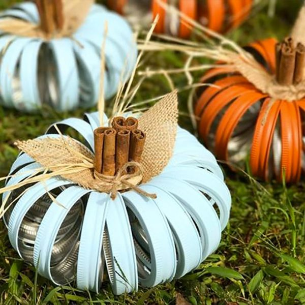 Innovative fall wedding decoration: rustic pumpkins made from mason jar lids, burlap, and cinnamon sticks. She will paint them in your choice of three colors. $25.00 Learn more through the second buy listing on the page. In the My Online Wedding Help products section. #MyOnlineWeddingHelp #WeddingDecorations #FallDecoration