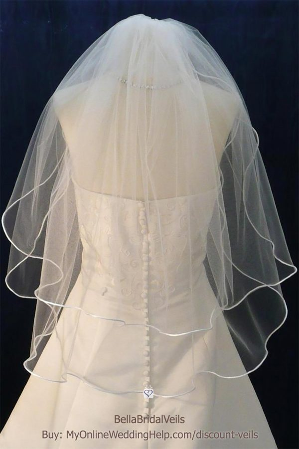 Two tier elbow length veil with pencil / rattail edge. Ribbon edge is also available. $40.00 Learn more or buy in the My Online Wedding Help products section. #WeddingVeil #TierVeil