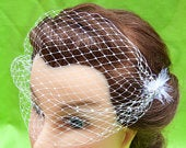 Neva birdcage veil, side closures with crystal and feather detail