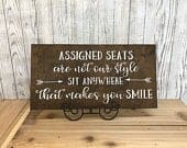 Assigned seats are not our style sit anywhere that makes you smile wedding sign