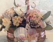 Beach wedding flower girl basket. Artfully arranged shells on opposite sides make this basket beautiful from every angle.