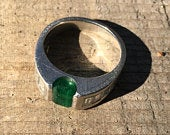 1 Ct. Emerald in Platinum cocktail ring with 1 Ct. Diamond Baguettes