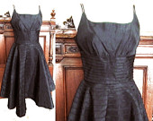 Vintage 1950s little black cocktail dress handcrafted black tafetta spaceage pleat sweetheat strap Mad Men full circle dress