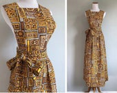 Vintage 1960s 1970s Pinafore Apron Dress Wrap Skirt Geo Novelty Print Maxi Retro Yellow Floral Cotton Barkcloth Prairie Size Small Medium