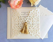 V174T Ivory shimmer laser cut floral lace gate fold double gold tassel embellishment wedding invitation