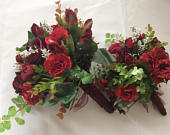 winter wedding bouquet in red and burgandy roses and rustic foliage with ribbon