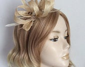 A NATURAL SINAMAY FASCINATOR, With Grizzly feathers, flat shell bead, on a 3mm silver headband, Colour Natural and Brown
