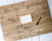 Wood personalised wedding guest book alternative with photo frame centre,for you to display your favourite photo from your wedding day.