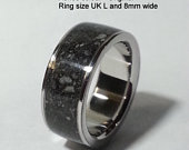 Handmade made ashes ring made with 316 surgical stainless steel and your cremation Ashes. The 8 photos are typical examples of these rings.
