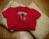 Girls knitted Bolero short sleeved in Christmas party red with a white organza ribbon fastening girls outfit 2 yrs