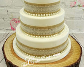 Vintage rustic wedding cake hessian and lace ribbon with strung Ivory Pearls