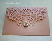Rose Gold Floral Pocket Wedding Invitation. Laser Cut Lace Effect Invitation with Rose Gold Pearl Flower.