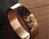 Large broken Rock wedding ring in yellow or rose gold.