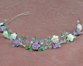 Lilac and pink bridal headpiece. Rustic wedding style with roses, green leaves on silver wire.