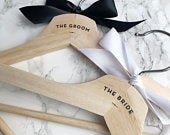 Bride and groom wedding hangers with black and white satin bows gift set of two engagement gift bride to be