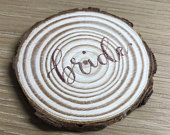 Rustic wood slice place cards with modern calligraphy lettering