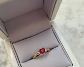 Heartshaped Ruby Ring with White Round Diamond Shoulder Stones, Set on a 9ct Yellow Gold Twisted Band