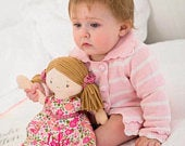 Beautiful soft touch personalised rag doll with pink floral dress.