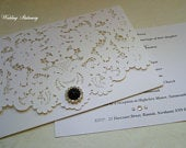 Black Pearl. Pocket Wedding Invitation. Lace Effect laser Cut Pocket with Jet Black and Diamante Button Embellishment.
