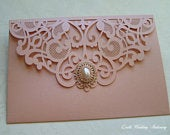 Rose Gold Laser Pocket Lace Effect Wedding invitation with Rose Gold Pearl Brooch.