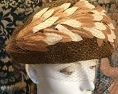 A Veil of Leaves 1950s Vintage Woven Hat with Netting Veil and Coffee Cream Layered Silk Leaves