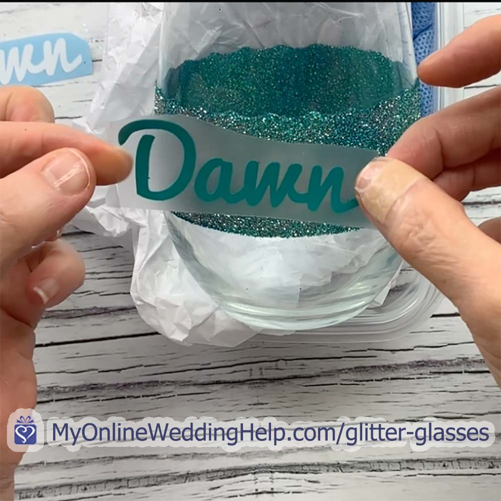 Step 3 to glitter wedding wine glass. Apply name and decoration.