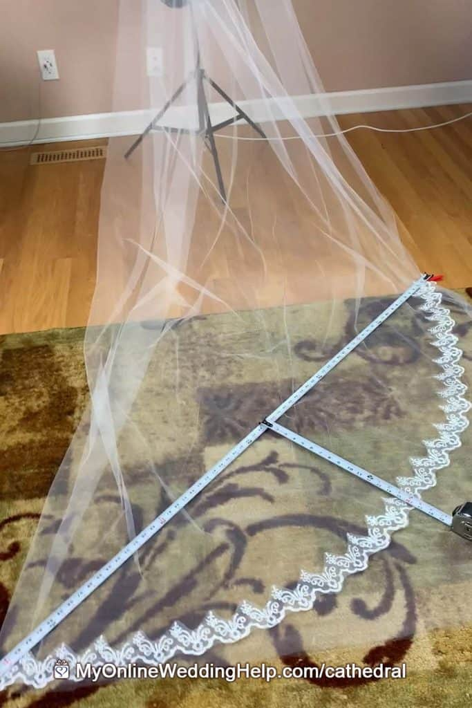 Cathedral veil DIY step 1. Tape measure, tulle, and lace showing how to find veil pattern size.