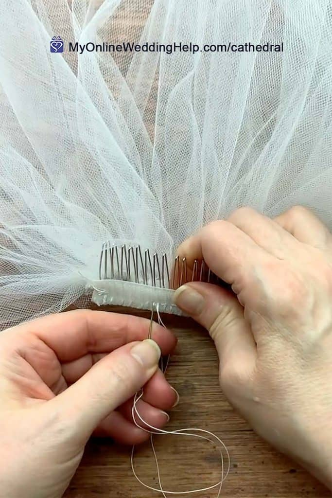 Overhead shot of veil sewn to comb. Needle moving through velcro and tulle.
