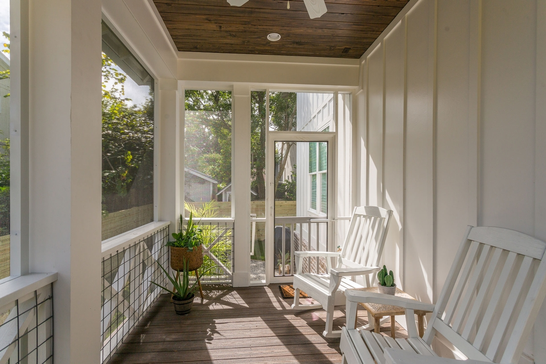 screened in porch, rocking chairs