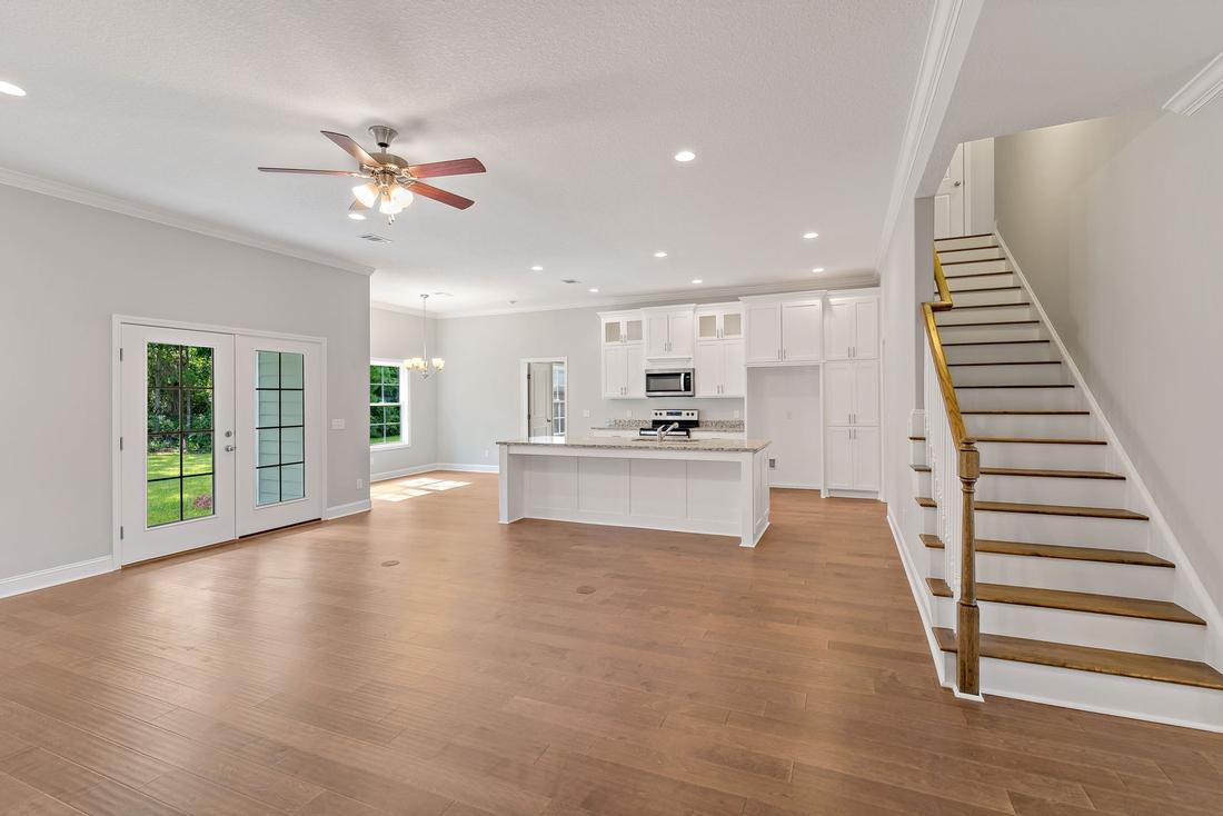 kitchen, kitchen island, stairs, wooden floors