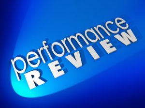 Performance Review in white 3d letters on a blue background to illustrate a work evaluation or assessment judging the quality of your output, attitude, skills and conduct