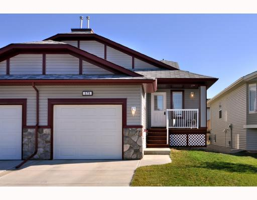 Main Photo: 579 STONEGATE Way NW: Airdrie Residential Attached for sale : MLS® # C3397152