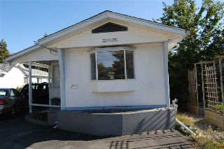 "Main Photo: 244 HIAWATHA Drive in West Vancouver: Park Royal Manufactured Home for sale in ""CAPILANO MOBILE HOME PARK"" : MLS® # R2215671"