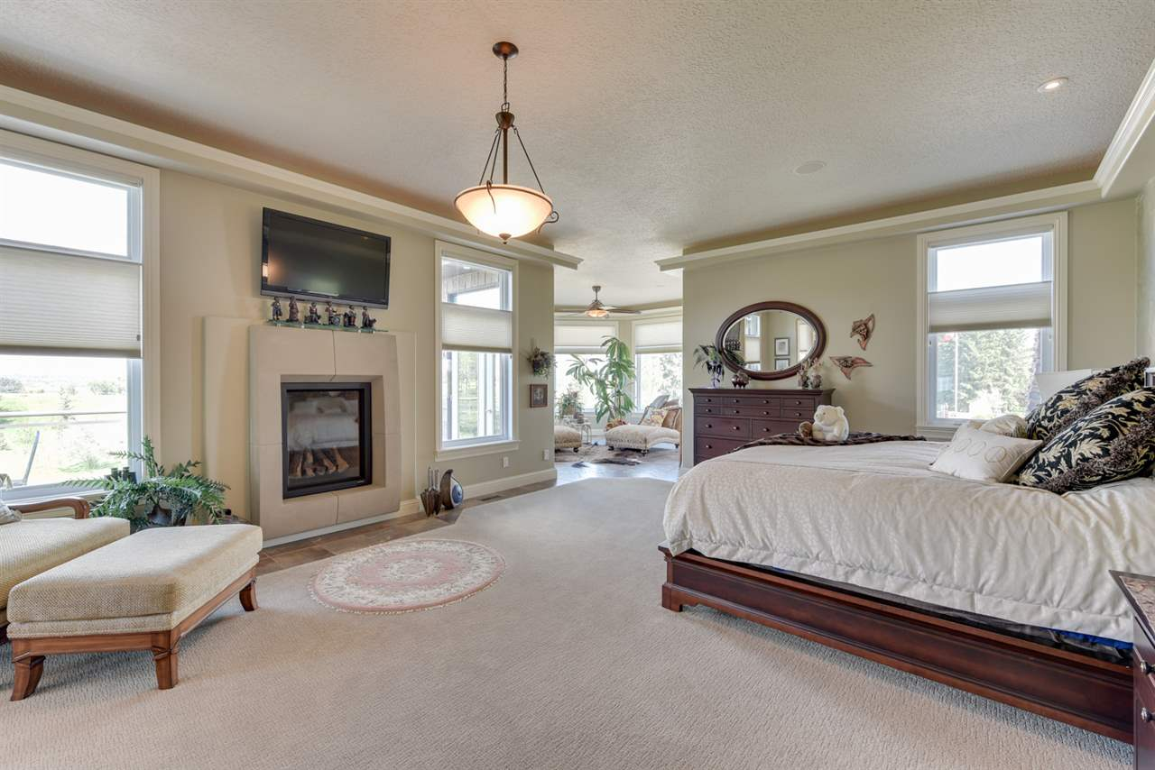 Private Master Suite with a fireplace and lots of natural light.