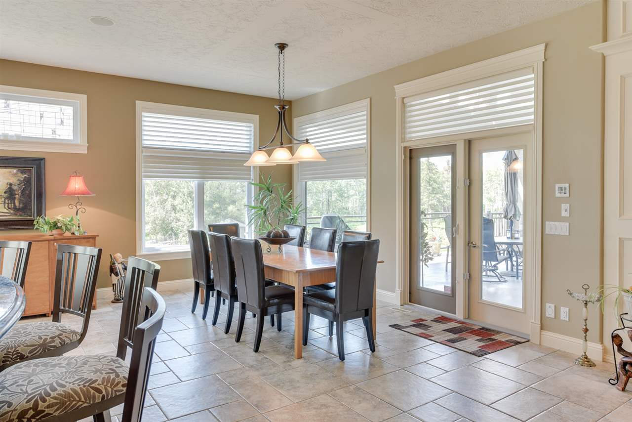 The generous dining area seats a dozen easily and overlooks the deck and yard with an abundance of windows. Convenient French door access to the upper heated patio where the barbeque is located. A aluminium and glass railing provide a gorgeous west view.
