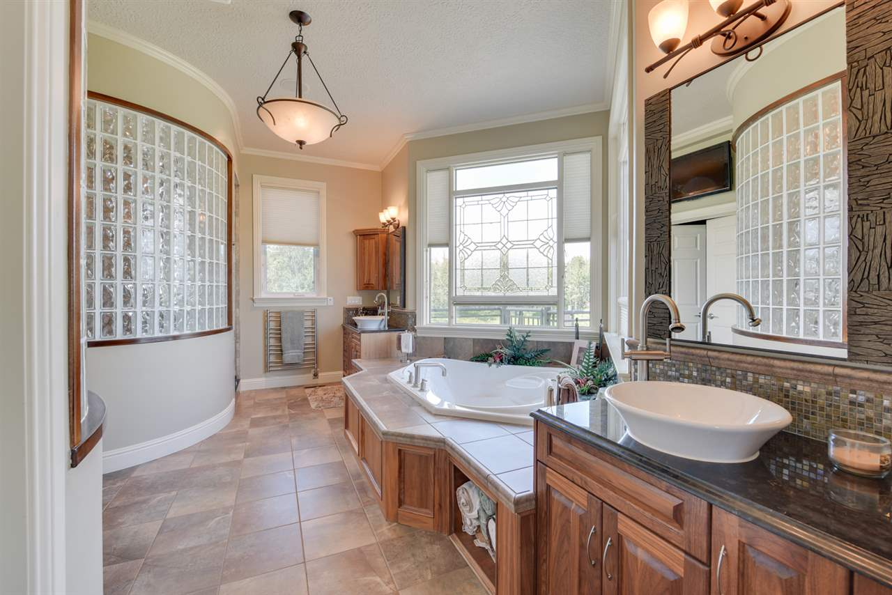 Double sinks, an extra large walk in shower with your choice of jets, bidet, Jacuzzi, custom privacy windows, heated floors, heated towel rack and a generous walk in closet are found in this beautiful ensuite!