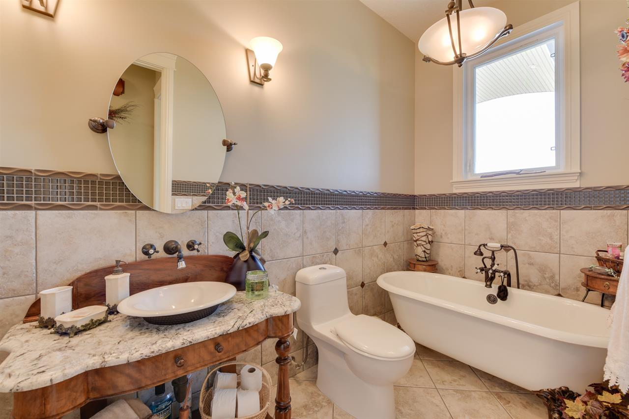 Check out this gorgeous guest bathroom located just off the foyer on the main floor!