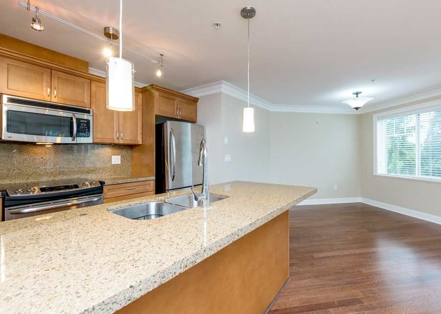 Elegance and quality. Southwest exposure brings lots of light. Open plan living area.