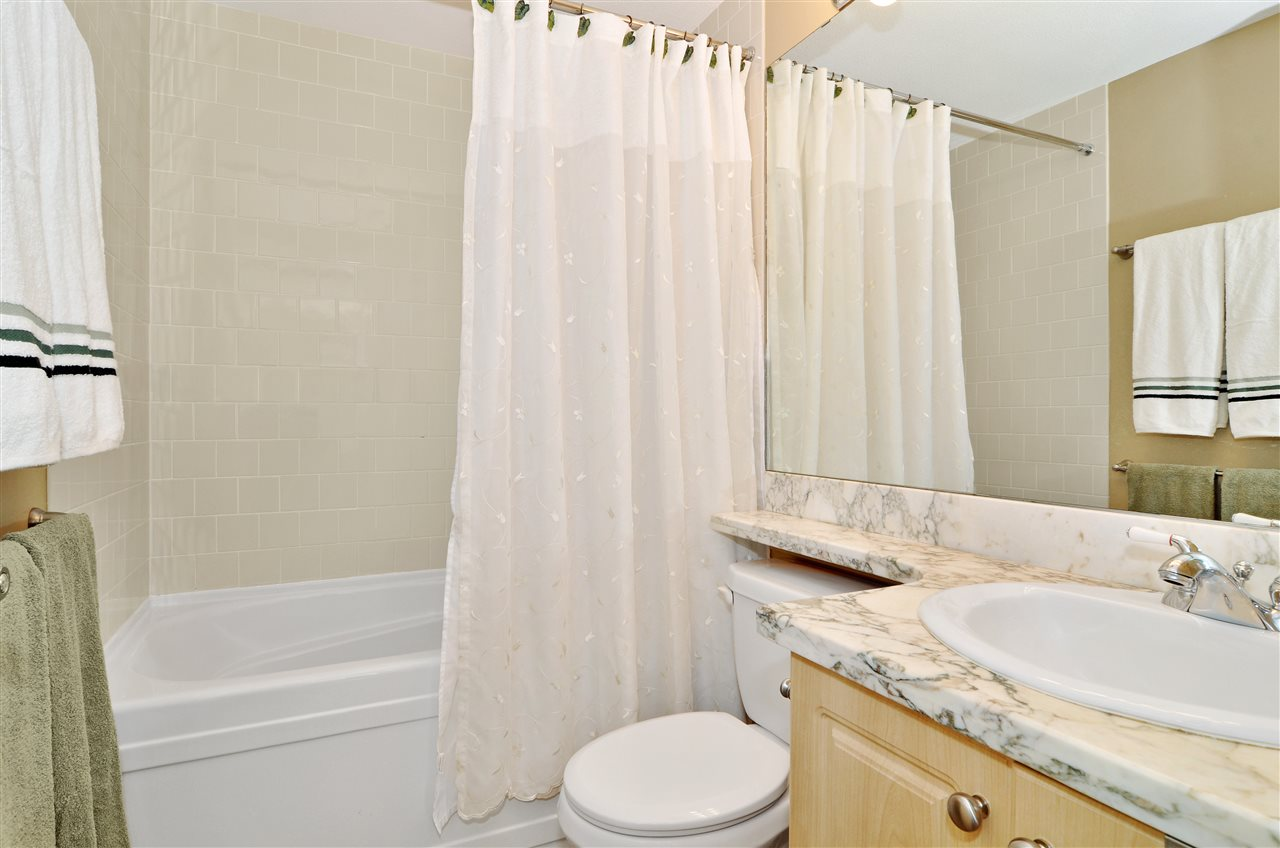 Very nice master ensuite bathroom with beautiful floors.