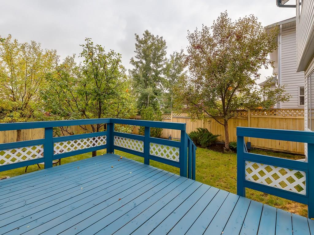 Rear deck leads to treed backyard