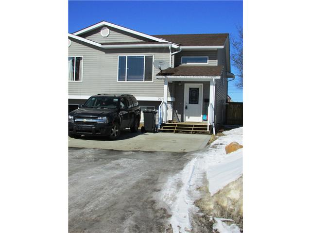 "Main Photo: 7916 97TH Avenue in Fort St. John: Fort St. John - City SE House 1/2 Duplex for sale in ""NORTH ANNEOFIELD"" (Fort St. John (Zone 60))  : MLS® # N234446"