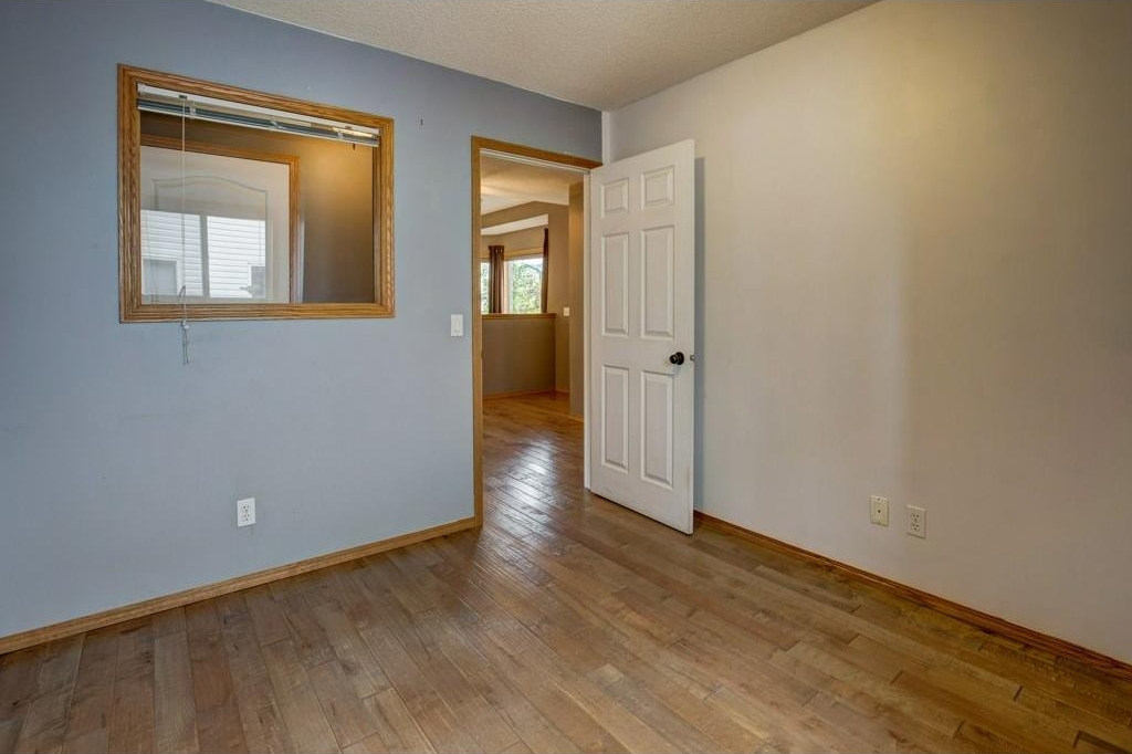 Main floor den/office with hardwood flooring.