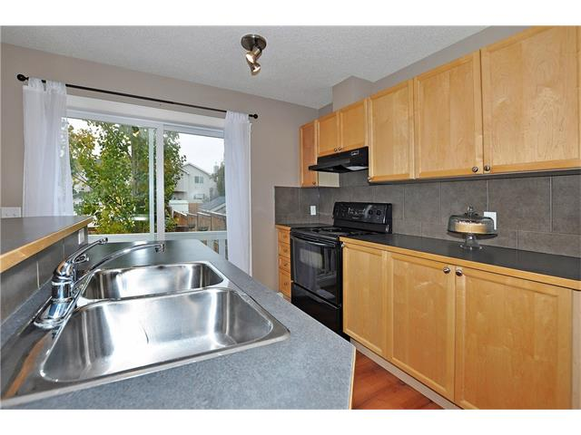 Photo 10: 32 TUSCANY RIDGE Way NW in Calgary: Tuscany House for sale : MLS® # C4086936