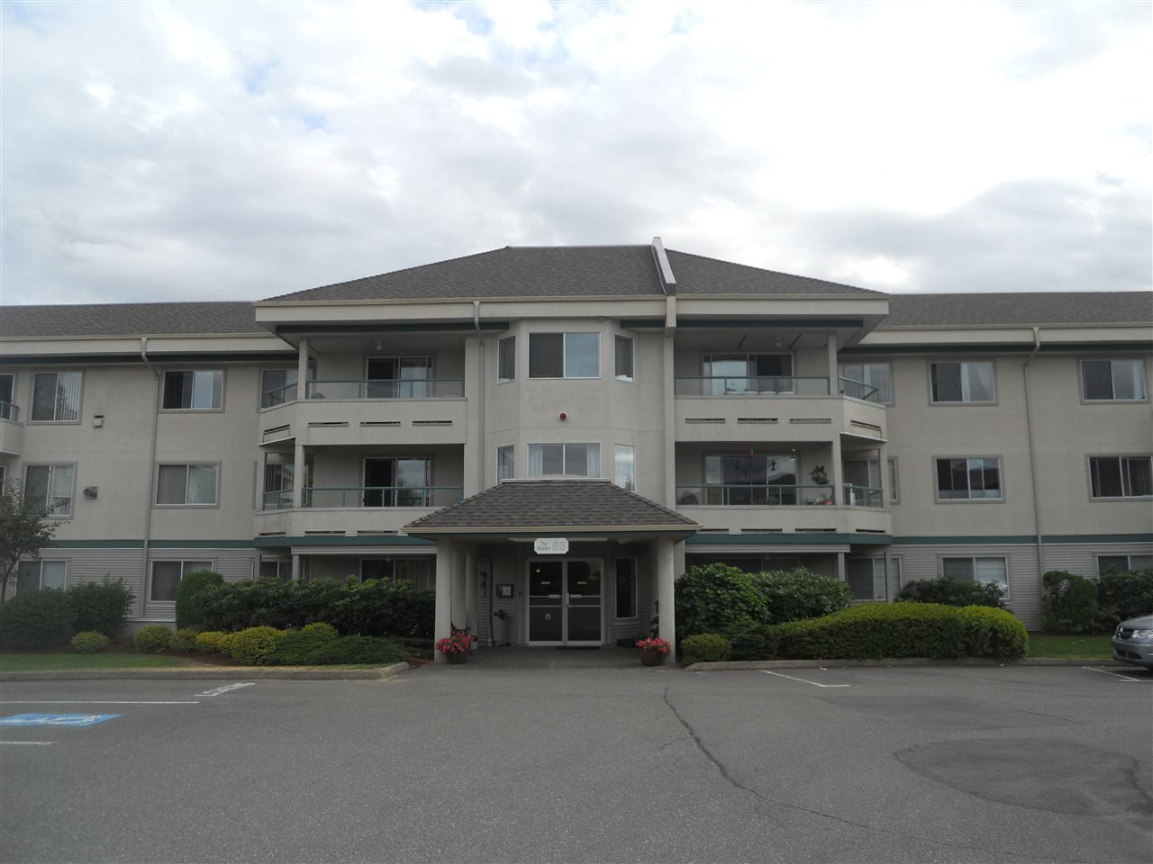 "Main Photo: 319 2451 GLADWIN Road in Abbotsford: Abbotsford West Condo for sale in ""Centennial Court"" : MLS®# R2197970"
