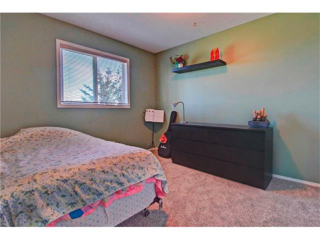 Photo 18: 125 SPRING Crescent SW in Calgary: Springbank Hill House for sale : MLS® # C4077797