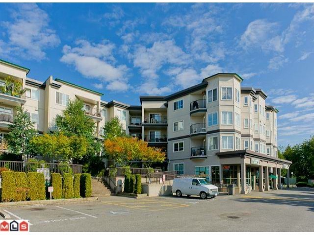 "Main Photo: 115 5765 GLOVER Road in Langley: Langley City Condo for sale in ""College Court"" : MLS®# F1209579"