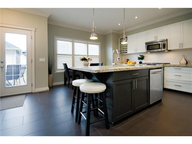 Photo 2: 187 YPRES Green SW in CALGARY: Garrison Woods Townhouse for sale (Calgary)  : MLS® # C3520663
