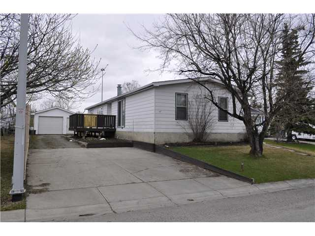 Welcome to this Great Double Wide with an Oversized Single Garage!