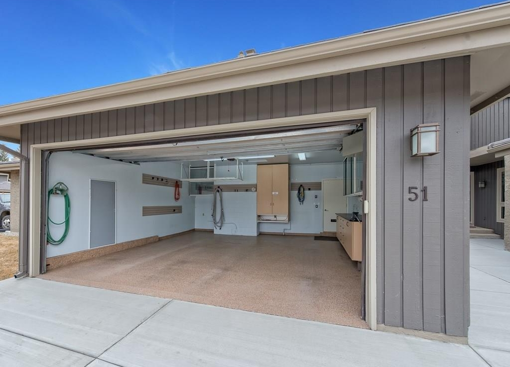 Oversized garage with 18' wide x 8' tall garage door.